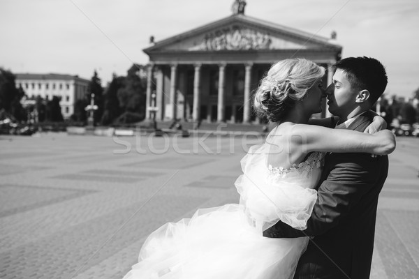 groom holds bride in his arms and twisted Stock photo © tekso