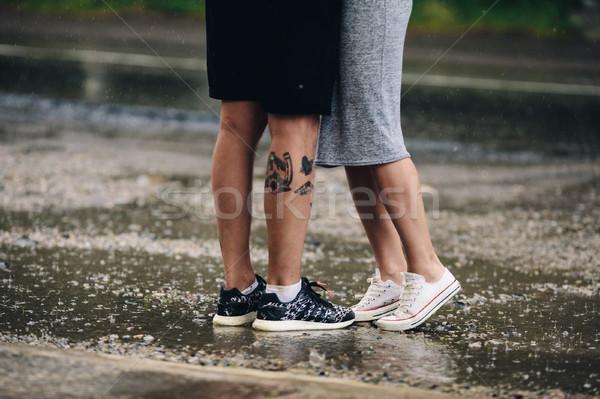 couple on the background of wet asphalt Stock photo © tekso