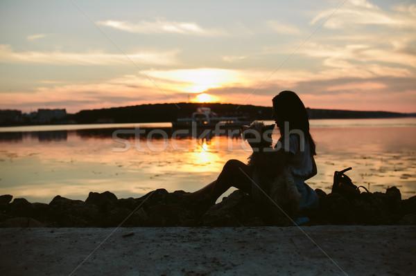 Kız köpek göl gün batımı gülümseme şehir Stok fotoğraf © tekso