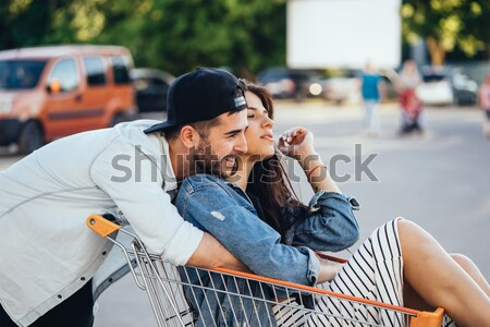 Happy couple in the street looking each other Stock photo © tekso