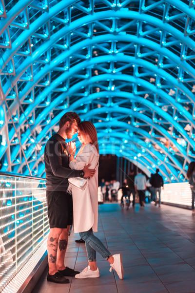 Loving couple on the bridge of Peace Stock photo © tekso