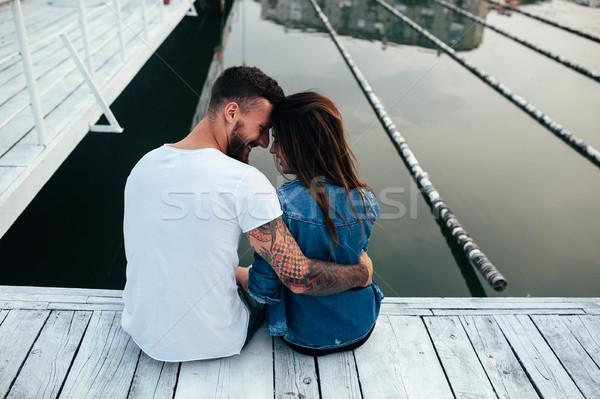 Couple hugging on pier Stock photo © tekso