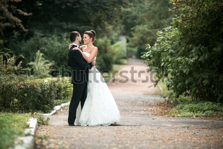 happy bride and groom posing in the autumn forest Stock photo © tekso