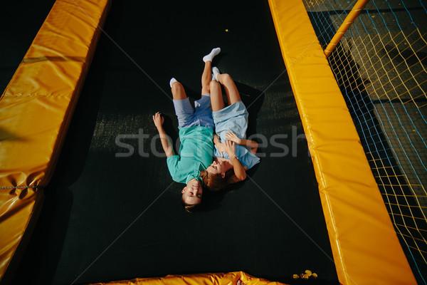 Pareja mentir trampolín parque feliz Foto stock © tekso