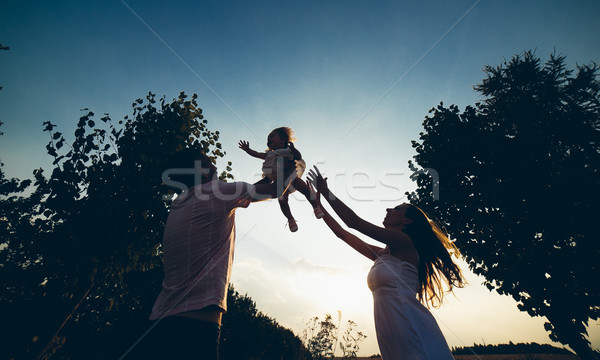 Parents and kid spending time Stock photo © tekso