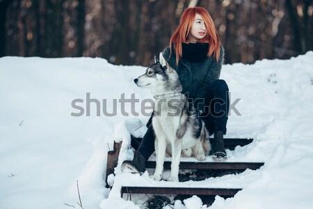 Beautiful girl with dog Husky in snowy woods Stock photo © tekso