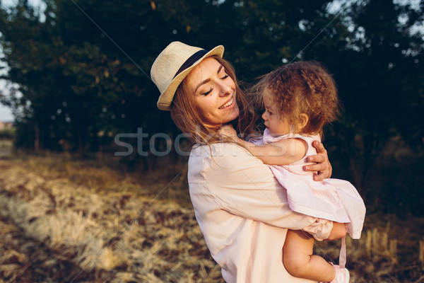 mother and daughter together outdoors Stock photo © tekso