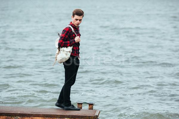 Człowiek stałego molo młody człowiek stwarzające wody Zdjęcia stock © tekso