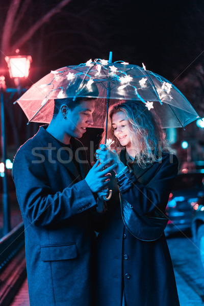Portrait of a guy and a girl under an umbrella Stock photo © tekso