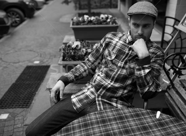 Man poseren jeans authentiek laarzen vergadering Stockfoto © tekso