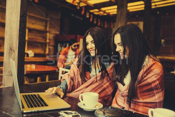 two girls watching something in laptop Stock photo © tekso