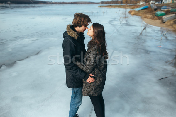 young beautiful couple on the ice of a frozen lake Stock photo © tekso