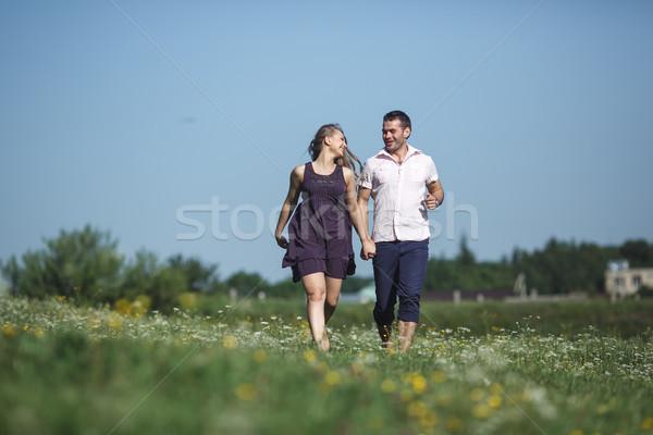 Pareja ejecutando campo diversión hermosa amor Foto stock © tekso