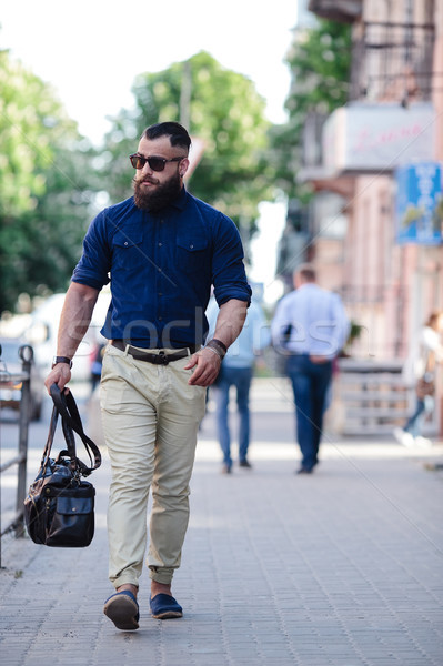 bearded man goes and listens to music Stock photo © tekso