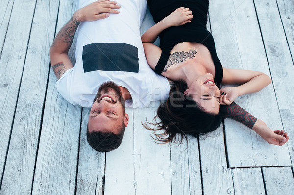 man and woman lie on the wooden floor Stock photo © tekso
