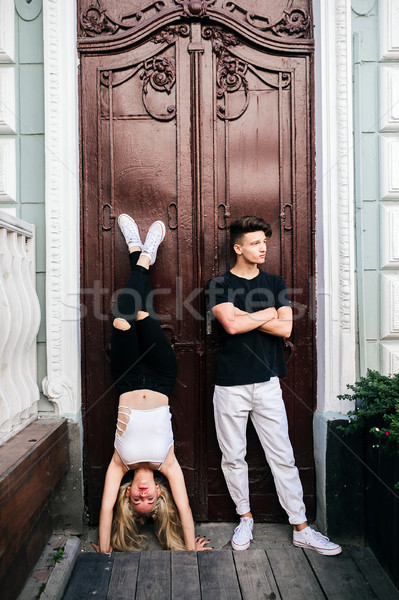 girl standing on the hands, a guy beside Stock photo © tekso