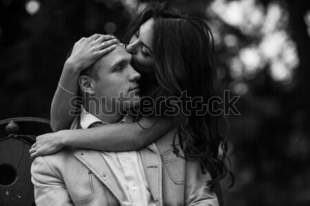 Fiatal európai pár ölelkezés park pad Stock fotó © tekso