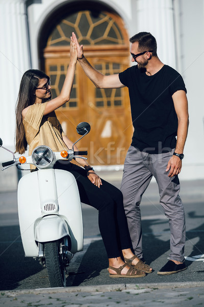 Cute couple with their scooter Stock photo © tekso