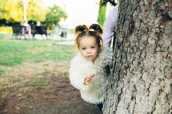Cute little girl is playing outdoors Stock photo © tekso