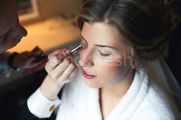 Applying make up to bride Stock photo © tekso