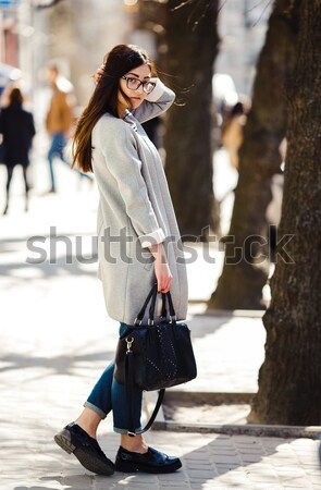 girl in a coat on the street Stock photo © tekso