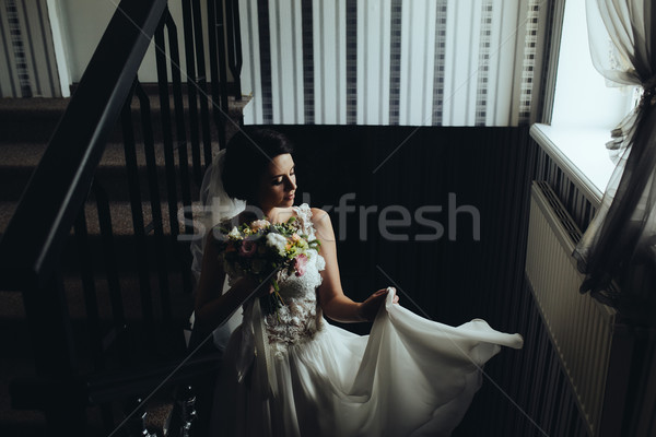 Bride posing on the chamber Stock photo © tekso