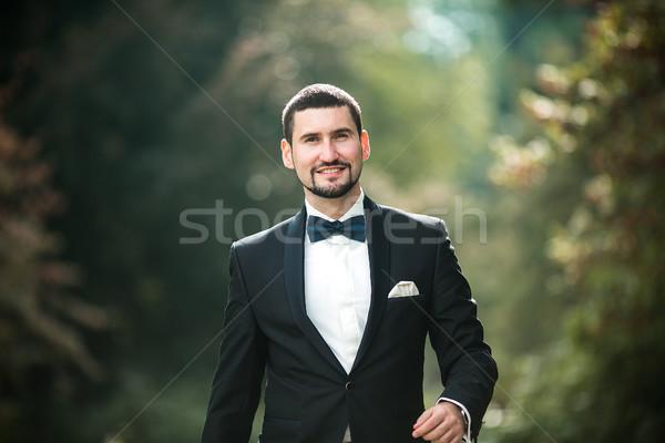 confident groom posing Stock photo © tekso