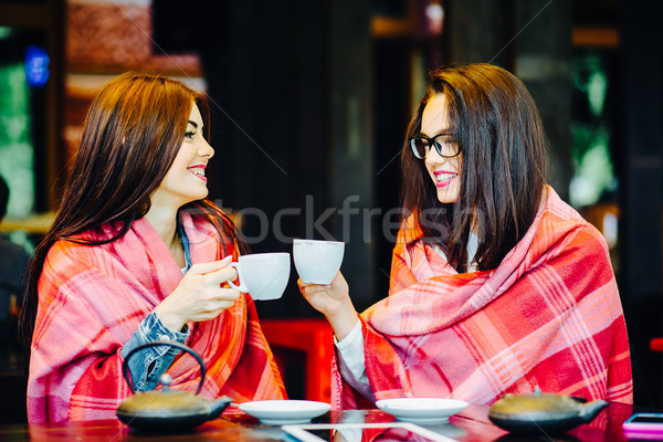 Two young and beautiful girls gossiping Stock photo © tekso