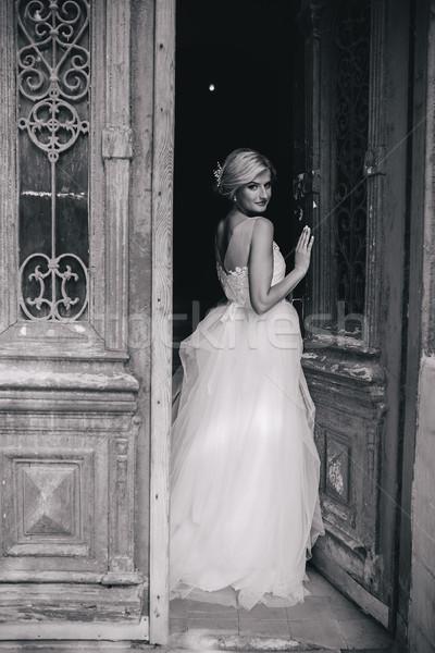 bride standing in front of the old door Stock photo © tekso