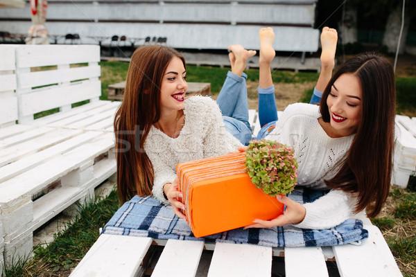 Kızlar yalan bank vermek diğer hediyeler Stok fotoğraf © tekso