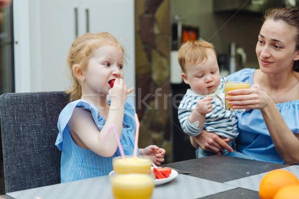 Happy family, fresh fruit breakfast Stock photo © tekso