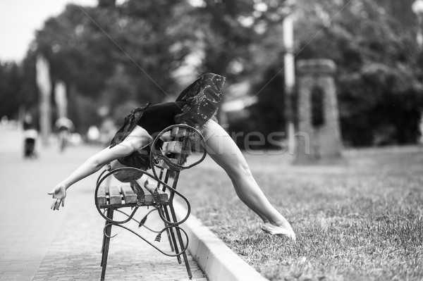 Ballerina bends back through the bench Stock photo © tekso