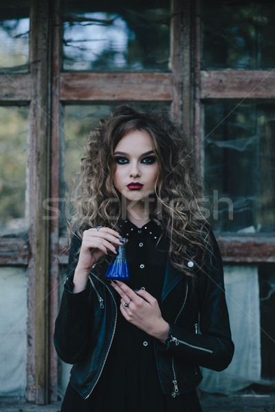 Vintage witch with elixir in hand Stock photo © tekso