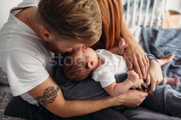 Happy family with newborn baby on the bed Stock photo © tekso