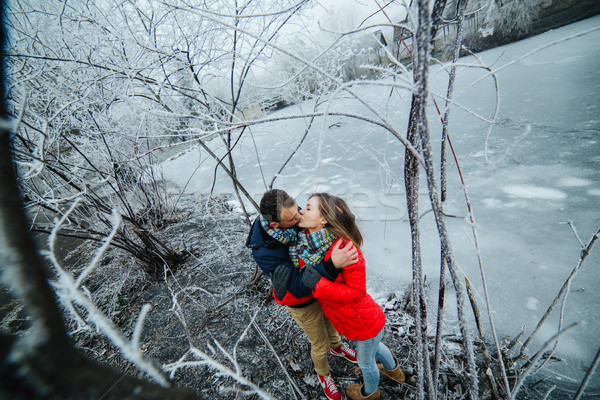 beautiful couple posing near a frozen river Stock photo © tekso