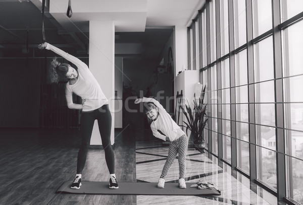 Two girls of different ages makeing yoga Stock photo © tekso