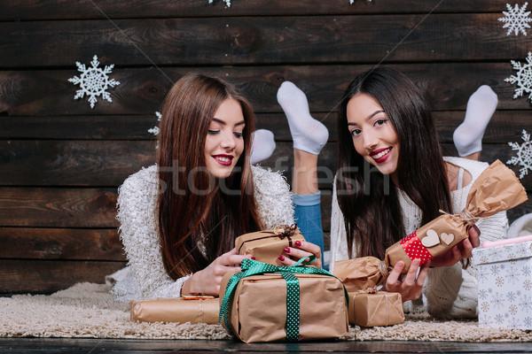 Dois belo meninas mentir piso presentes Foto stock © tekso