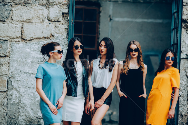 Five young beautiful girls in the city Stock photo © tekso