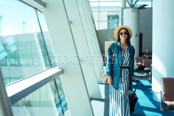 Woman go travel with suit case at airport Stock photo © tekso