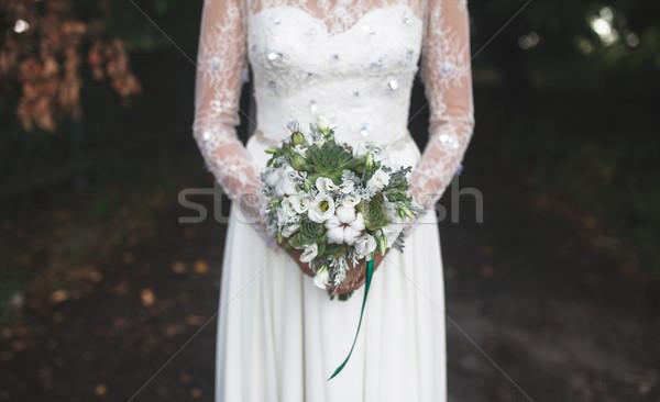 Bride holding wedding bouquet Stock photo © tekso
