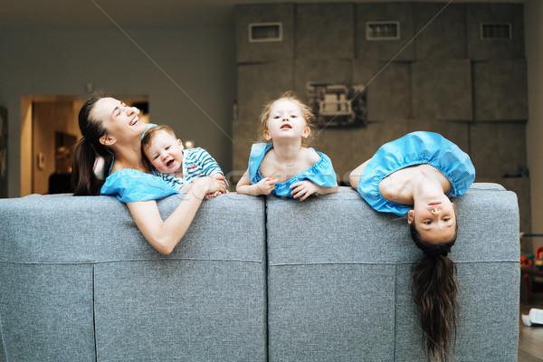 Anne iki küçük oğul kanepe Stok fotoğraf © tekso