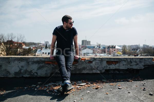 Confident man posing in selvedge  jeans Stock photo © tekso