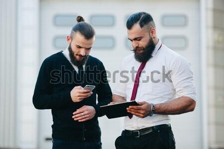 Dos empresarios algo mirando negocios Foto stock © tekso