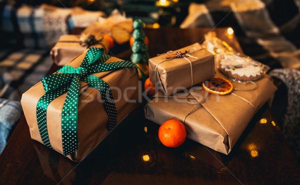 Geschenken liggen houten tafel mooie sneeuw achtergrond Stockfoto © tekso
