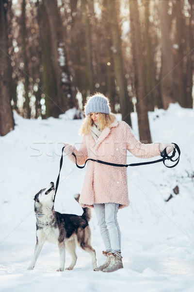 Beautiful girl with dog Husky in snowy woods Stock photo © tekso