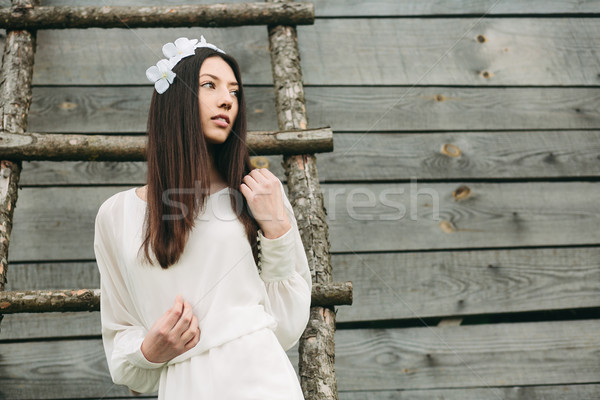 Girl climbing ladder into tree house Stock photo © tekso