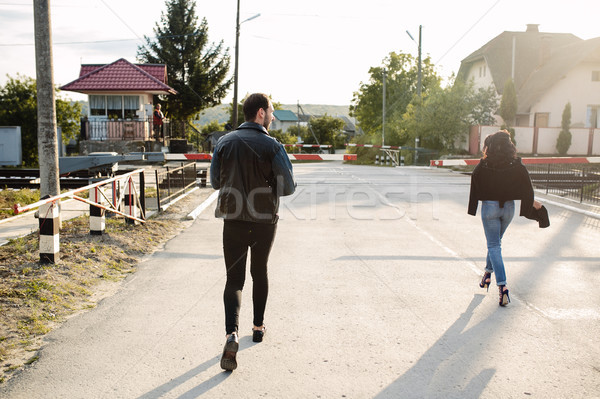 man and woman running to the railroad crossing Stock photo © tekso
