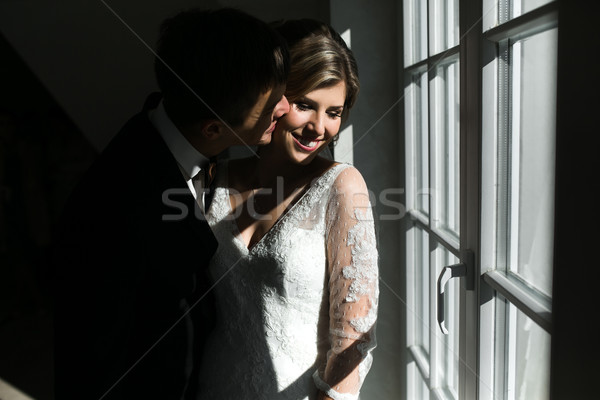 bride and groom on the background of a window. Stock photo © tekso
