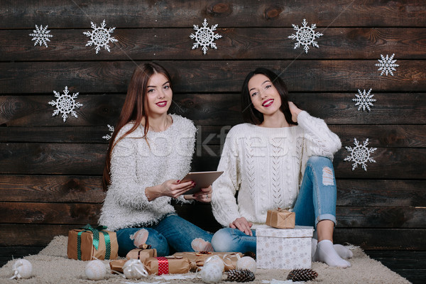 Two beautiful girls with a tablet, between gifts Stock photo © tekso