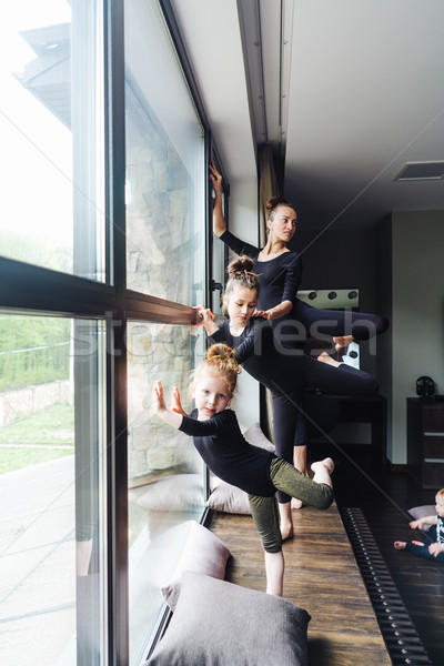 Mom and two daughters practice ballet Stock photo © tekso